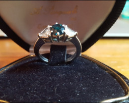 18ct solid white gold ring with 2 white and a 1 blue Natural Diamond