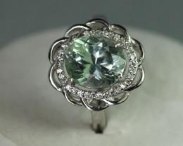 Green kunzite 4.0 cts  white Rhodium 925 Sterling silver ring