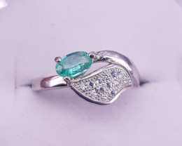 Emerald Ring with small Zircons.