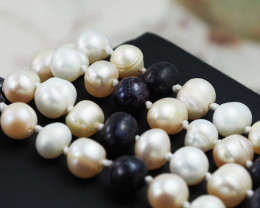 Long 1.1 meter semi  round graded high luster pearl strand  AGR 983