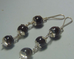 Crafted garnet earrings 999 silver designs