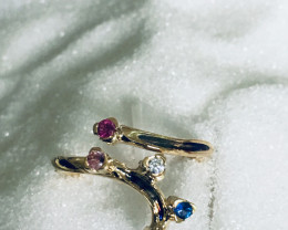 ring yellow gold 18 kt with titanium and colored sapphires and 1 brilliant