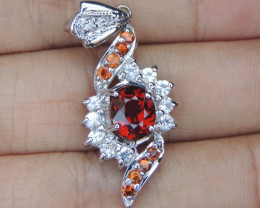 3.15cts Spessartite with Sapphire in Silver