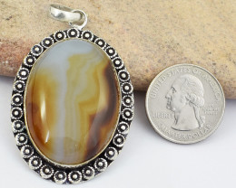 Genuine 124.00 Cts Onyx Tibet Silver Pendant