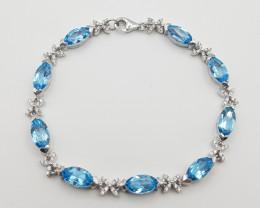 Stunning Blue Topaz Bracelet With CZ In Silver