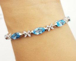 Stunning Blue Topaz Bracelet With CZ In Silver