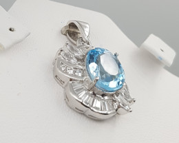 Stunning Blue Topaz Pendant With White Zircons.