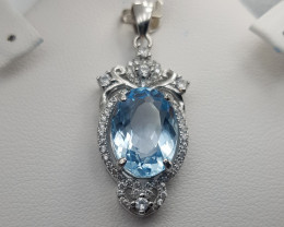 Natural Blue Topaz Pendant With CZ.