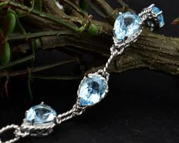Stunning Genuine Blue Topaz Bracelet In Silver