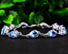 Stunning Genuine Blue Topaz Bracelet In Silver
