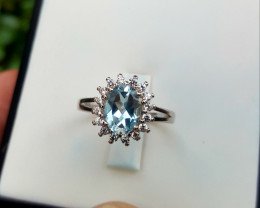 Natural swiss Blue Topaz with CZ Ring