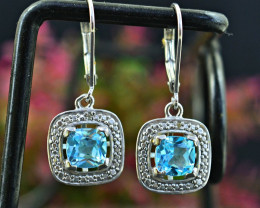Stunning Genuine Blue Topaz Earrings In Silver