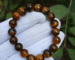 10 mm brown tiger eye beads bracelet, 134 carats.