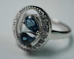 92.5 Swiss Blue Topaz With Solid Silver Ring Cz 19.00 Crt