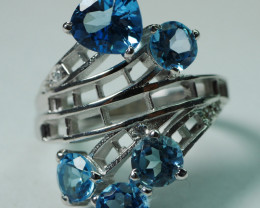 BEAUTY NATURAL TOPAZ 92.5  STERLING SILVER SIZE . (7 US)