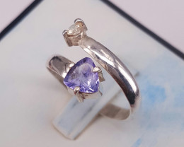 Natural Tanzanite and small white sapphire