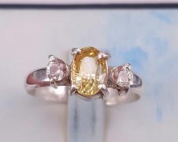 Natural Chrysoberyl/Alexandrite and white sapphire.