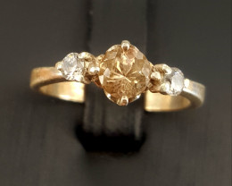 Natural Topaz Ring with CZ .