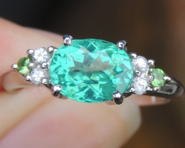 Neon Paraiba colored Apatite w/ Sapphries & Tsavorite in Rhodium