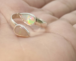 Open 950 silver ring with solid opal drop