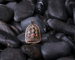 Tibetan brass pendant with coral stone