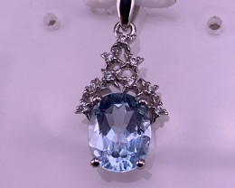Natural Topaz pendent with CZ.