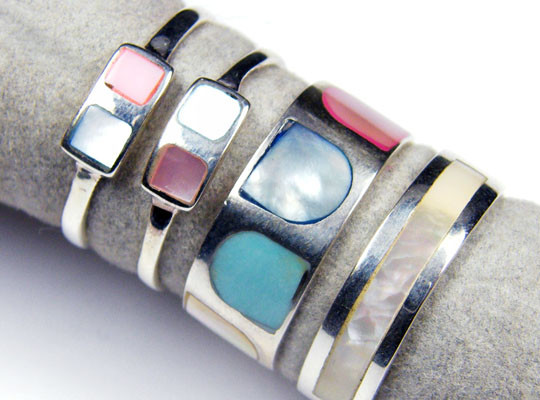 FOUR MOTHER PEARL RINGS ,RING SIZE5-6  MJA1
