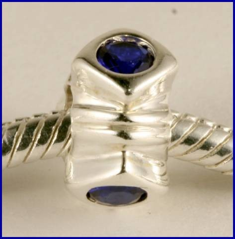 Sterling Silver Charm set with created Sapphire SG44