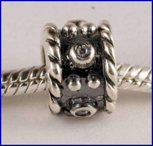 Sterling Silver Charm set with created Topaz SG50