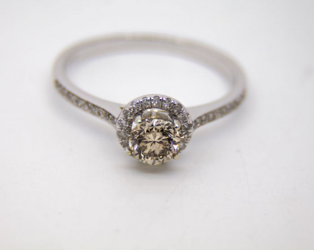 14 kt gold ring  with central diamond 0.41 ct. and side diamonds 0.12 ct.