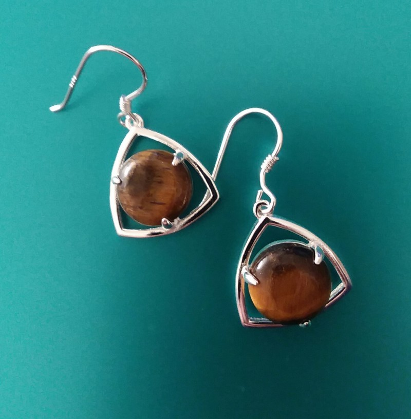 STERLING SILVER CASTING WITH TIGERS EYE CABACHON GEMS.. SPECTACULAR.....
