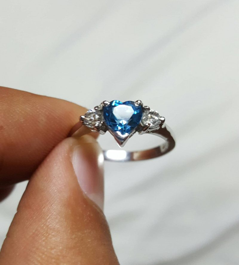 Natural Blue Topaz Ring with Small white Zircon