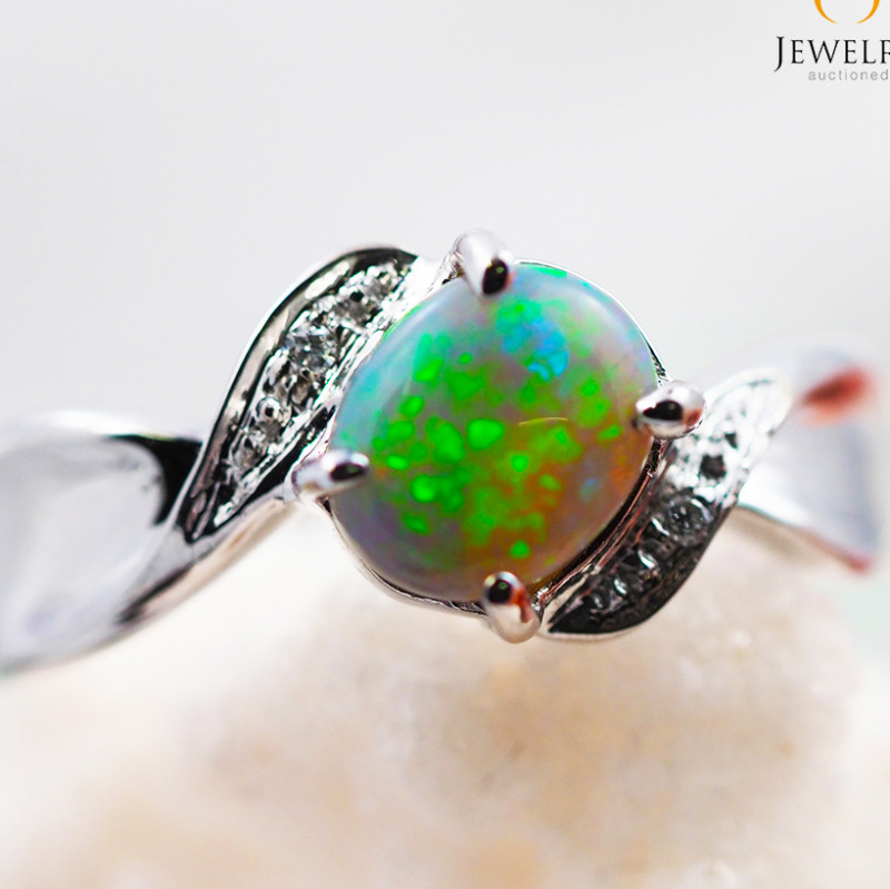 Solid Fire Opal  set in 18k white gold ring size 7 - RO2