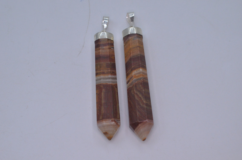 130.30 Ct  Natural Calcite Pendent with silver