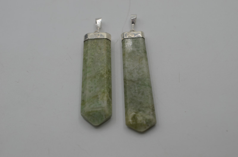 131.80 Ct Natural Calcite Pendent with silver