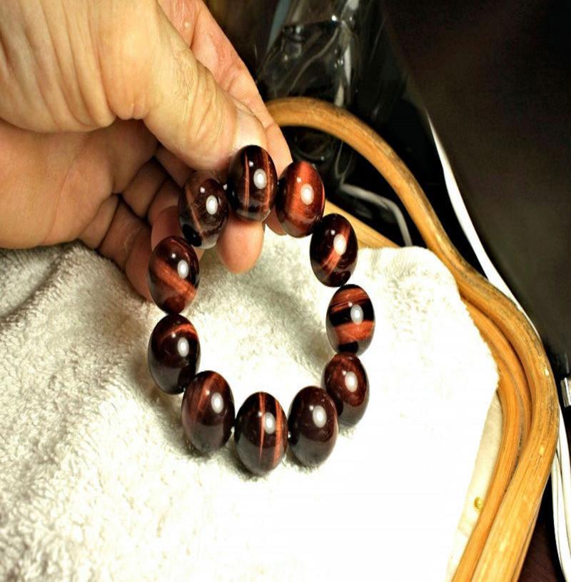 484.0 Tcw. China Red Tiger Eye Bracelet - Superb