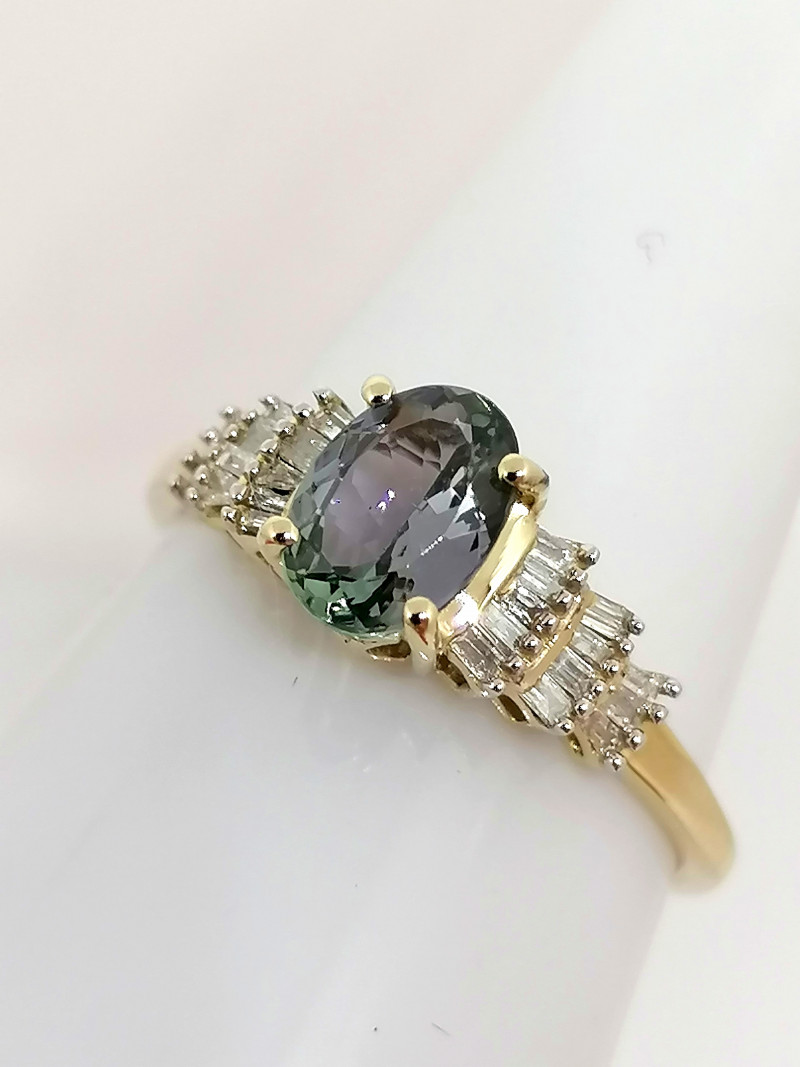 Peacock Tanzanite and Diamond Ring 1.00 TCW - 9kt. Gold
