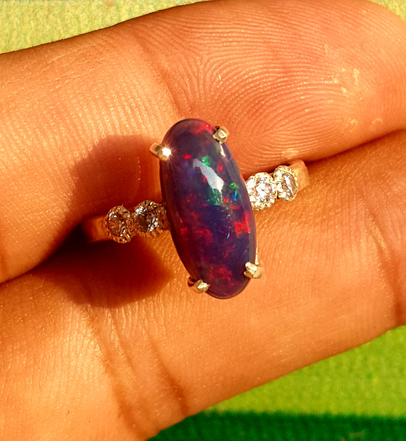 Natural welo fire black Opal and Cz Ring.