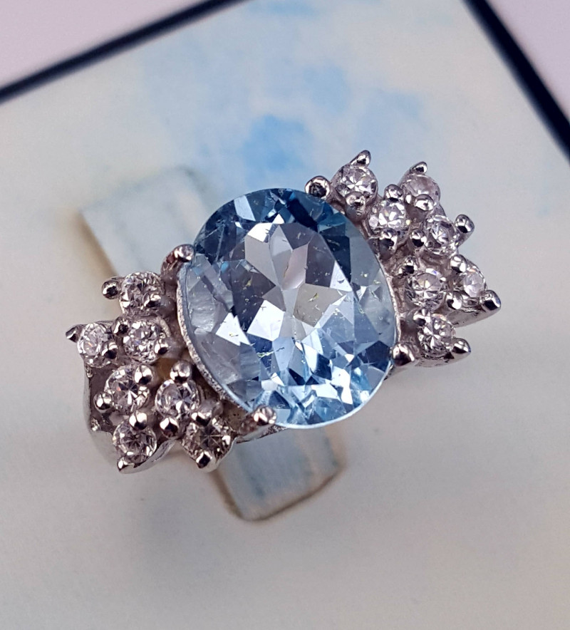 Natural swiss blue topaz with CZ Ring.
