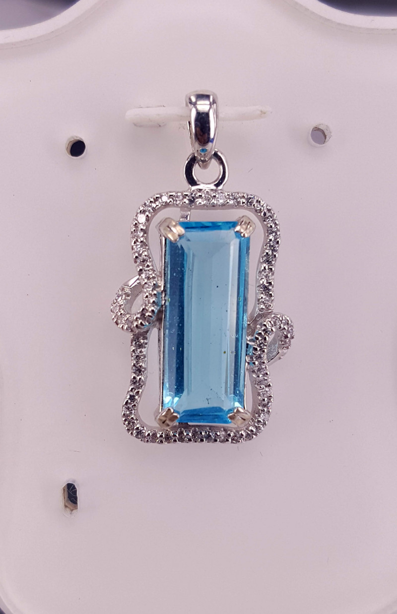 Natural Swiss Topaz with CZ Pendent.
