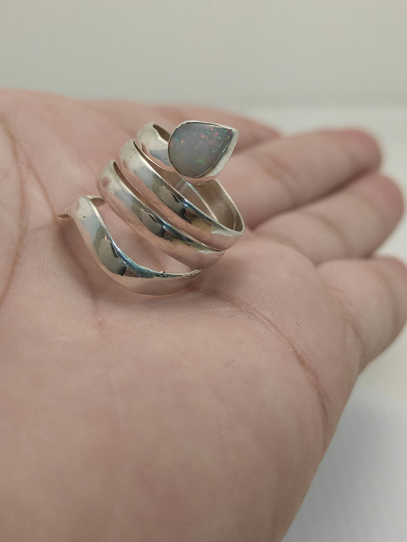 Silver ring in snake shape 950 with solid opal drop shape