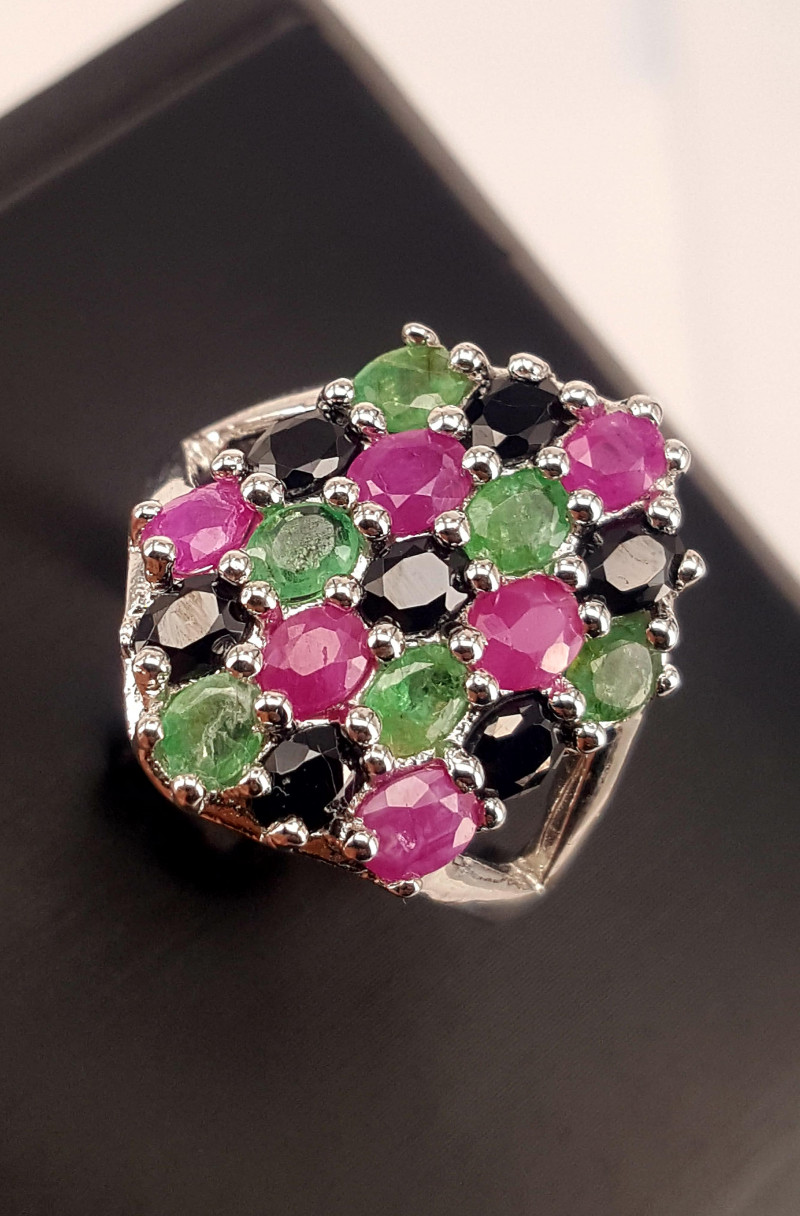 Natural Emerald Ruby and Sapphire Ring .