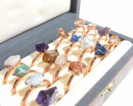16 Raw Gemstones in copper rings Br 2440