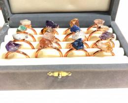 16 Raw Gemstones in copper rings Br 2442