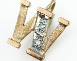 0.439 Grams 9 K   - W 2Diamonds Gold Pendant [T64]