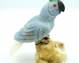 Hand carved Peruvian Parrot on mineral specimen RN 11