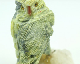 Hand carved Peruvian Owl on mineral specimen RN 12