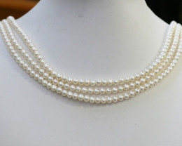 Three White side drill /baroque 4 mm Natural Pearl strands CCC1991