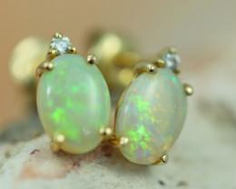 Cute Crystal  Opal set in 14k Yellow Gold Earring CK 537