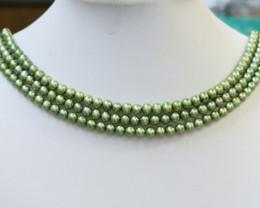 Three Pistachio Green Semi Round Pearl strands GOGO 1074